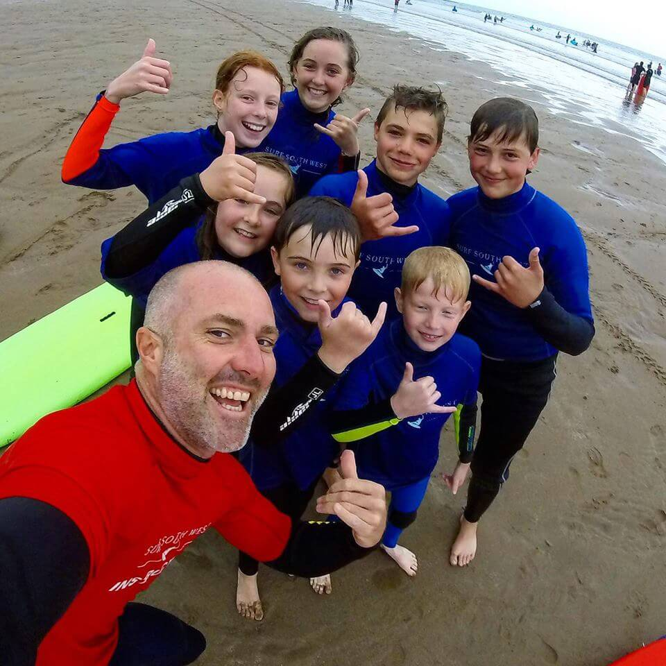 Happy Surfers from a schools group